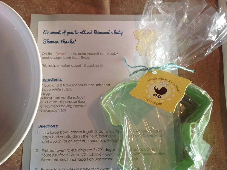 Favors: Onesie shaped cookie cutter along with a recipe card for baking sugar cookies