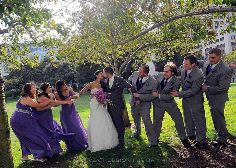 bridesmaids and grromsmen in bridal party ensemble pose for fun photo by san francisco wedding photographer