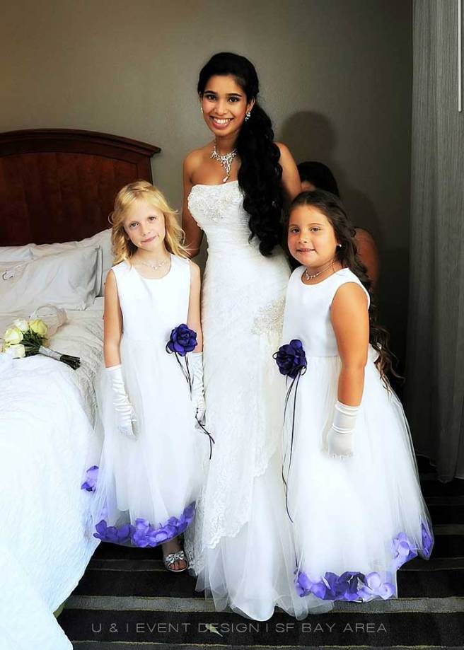 photo of bride with her flower girls at event by san francisco wedding planner