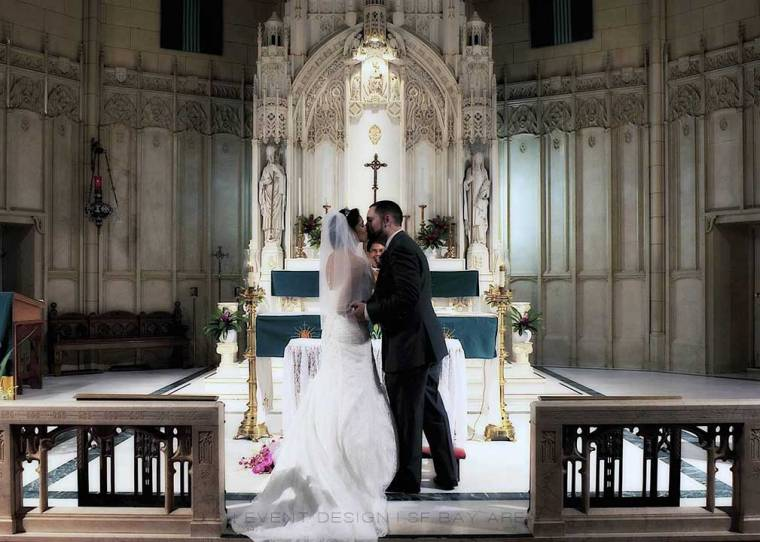 bride and groom kiss at st. patricks catholic church san francisco bay area wedding venue