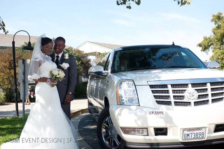 wedding couple posing next to limo by east bay engagement photographer