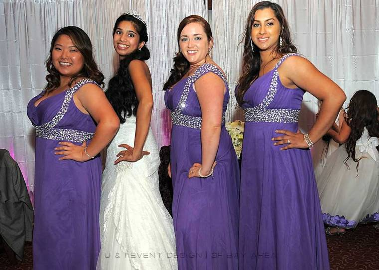 posing in bridesmaids dresses at event by bay area california multicultural wedding planner