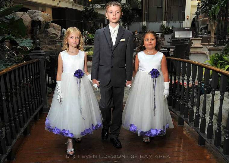 purple flower girl dresses and ring bearer suit at event by bay area wedding planner