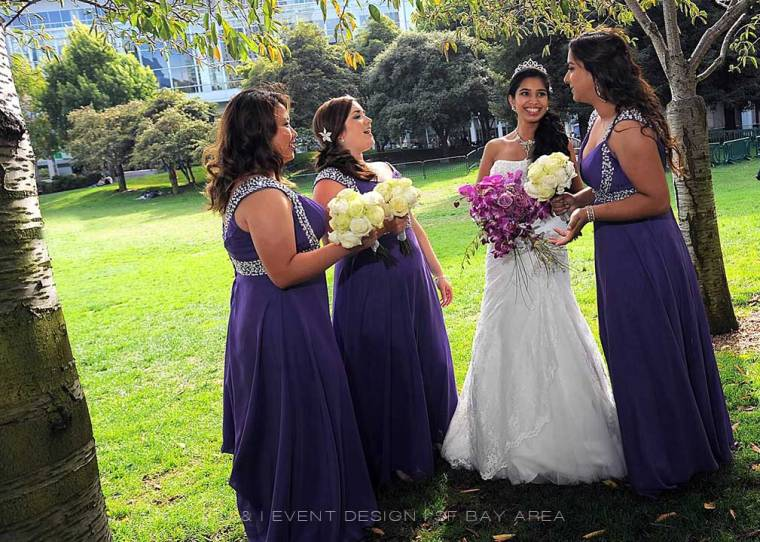 bride and bridesmaids in beautiful dresses holding flowers by Oakland bay area wedding florist