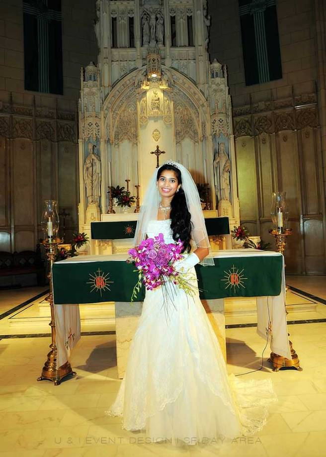 indian bride holding purple flowers after ceremony at saint patricks catholic church san francisco wedding venue