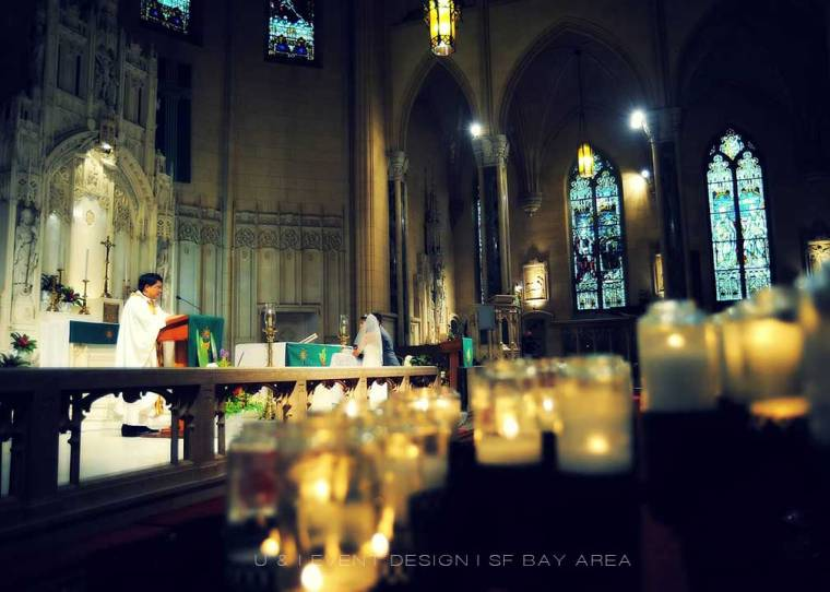 candle lights at church wedding ceremony planned by bay area wedding planner