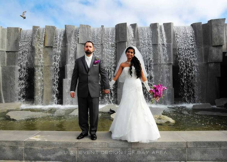wedding photo idea of bride and groom standing in front of waterfall by bay area phootographer