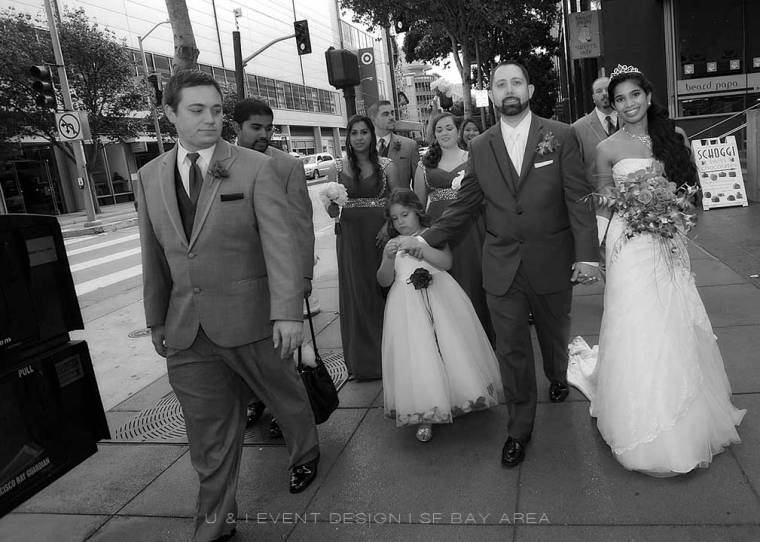 bridal party walking on downtown san francisco street for a wedding planned by bay area planner
